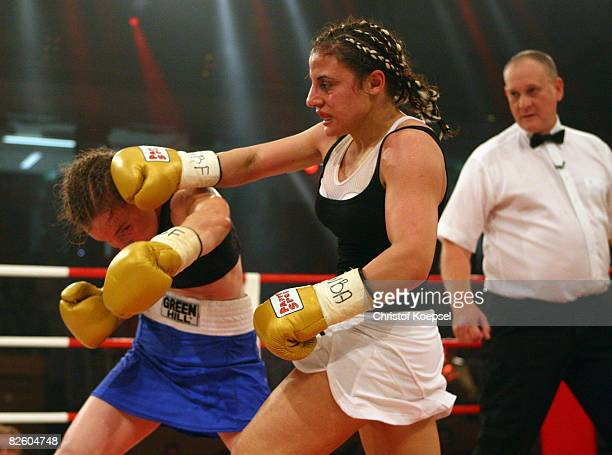 Susianna Kentikian of Germany boxes Hagar Shmoulefeld Finer of Israel during the WIBF and WBA flyweight world championship fight at the BurgWaechter...