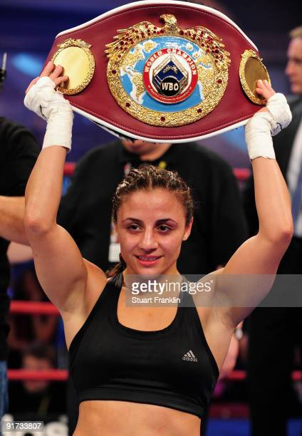 Susianna Kentikian of Germany celebrates after winning her fight against Julia Sahin of Germany during the WIBF WBC and WBO flyweight world...