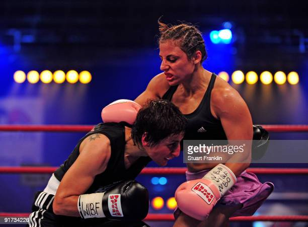 Susianna Kentikian of Germany exchanges punches with Julia Sahin of Germany during the WIBF WBC and WBO flyweight world championship fight during the...