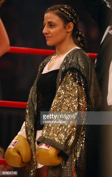 Susianna Kentikian of Germany hears the national anthem before the fight against Hagar Shmoulefeld Finer of Israel during the WIBF and WBA flyweight...