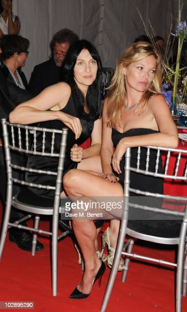 Susie Bick and Kate Moss attend a benefit evening for The Hoping Foundation on July 10 2010 in London England