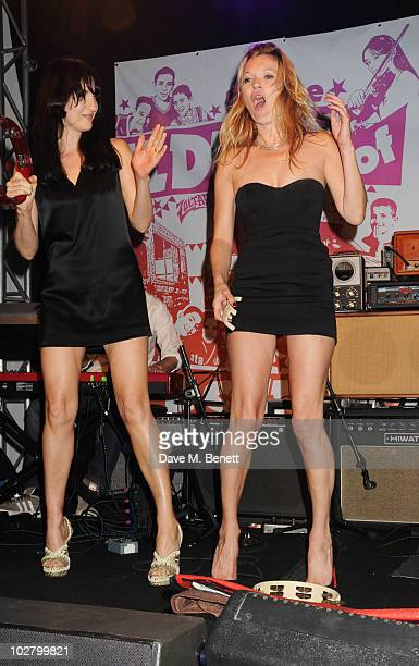 Susie Bick and Kate Moss perform at a benefit evening for The Hoping Foundation on July 10 2010 in London England