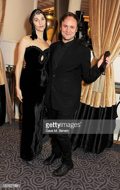 Susie Bick and Nicholas Kirkwood winner of the Accessory Designer award pose with award at the British Fashion Awards 2012 at The Savoy Theatre on...