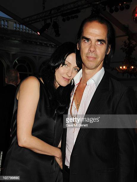 Susie Bick and Nick Cave attend a benefit evening for The Hoping Foundation on July 10 2010 in London England