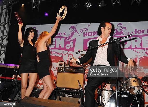 Susie Bick Kate Moss and Nick Cave perform at a benefit evening for The Hoping Foundation on July 10 2010 in London England