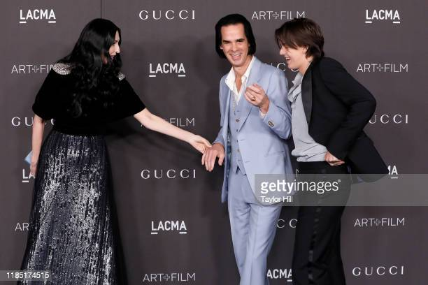 Susie Bick Nick Cave and Earl Cave attend the 2019 LACMA Art Film Gala at LACMA on November 02 2019 in Los Angeles California