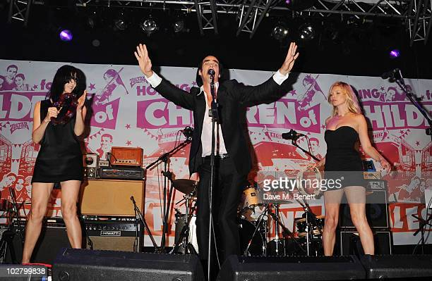 Susie Bick Nick Cave and Kate Moss perform at a benefit evening for The Hoping Foundation on July 10 2010 in London England