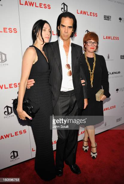 Susie Bick screenwriter/composer Nick Cave and photographer Polly Borland arrive at LAWLESS premiere in Los Angeles hosted By DeLeon and Presented by...