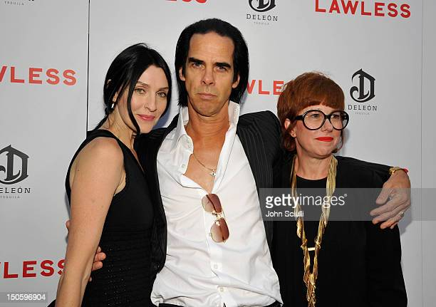 Susie Bick screenwriter/composer Nick Cave and photographer Polly Borland arrive at 'LAWLESS' premiere in Los Angeles hosted By DeLeon and Presented...