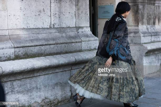 Susie Bubble wears a Dior dress Balenciaga a leather jacket and Coach shoes shoes during Couture SS19 Fashion Week on January 21 2019 in Paris France