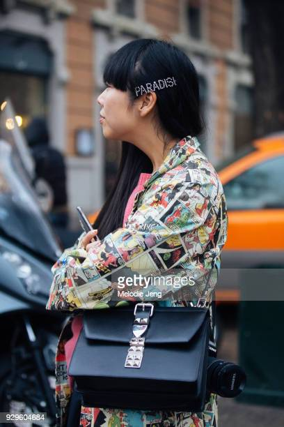 Susie Bubble wears an Ashley Williams Paradise hair clip a Prada comicstrip shirt and a black Prada bag during Milan Fashion Week Fall/Winter 2018/19...