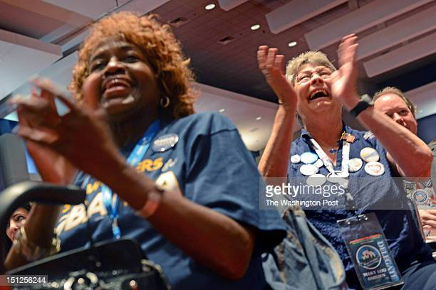 Susie Camper and Mary Lou Osburn cheer on speakers at the Women's Caucus held at the Charlotte Convention Center held in downtown Charlotte NC on...