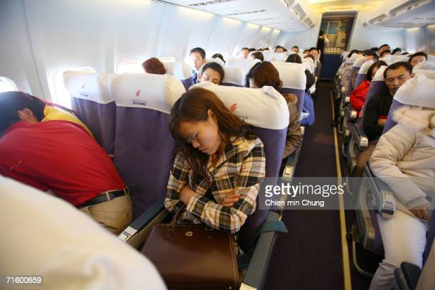 Susie Cheng sleeps during her flight to Sichuan on December 3, 2005 in Guangdong Province, China.