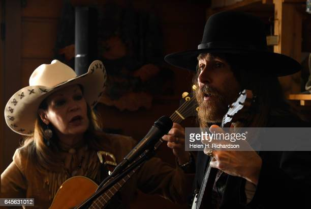 Susie Knight a poet and western singer left sings 1880's style songs with singer Rex Rideout right during the 100th anniversary celebrations of the...