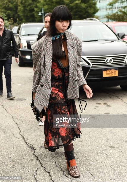 Susie Lau is seen wearing a Coach dress outside the Coach 1941 show during New York Fashion Week: Women's S/S 2019 on September 11, 2018 in New York...