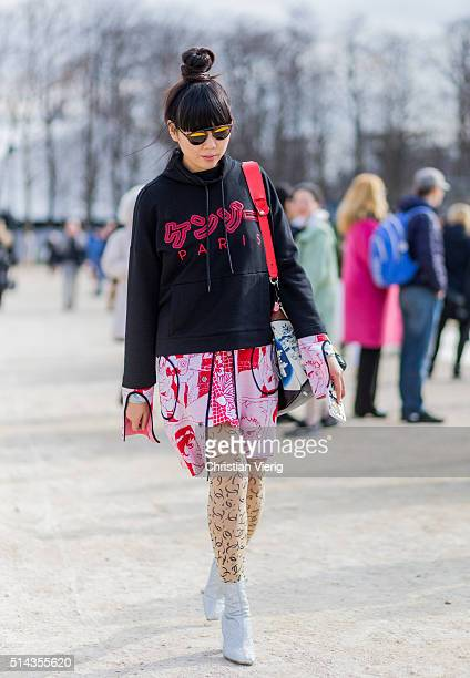 Susie Lau is wearing a black hoody outside Valentino during the Paris Fashion Week Womenswear Fall/Winter 2016/2017 on March 8 2016 in Paris France