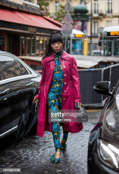 Susie Lau seen wearing blue overall with floral print, red coat outside Lanvin during Paris Fashion Week - Womenswear Spring Summer 2022 on October...