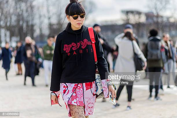 Susie Lau wearing a black hoody outside Valentino during the Paris Fashion Week Womenswear Fall/Winter 2016/2017 on March 8 2016 in Paris France