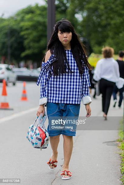 Susie Lau wearing a blue white plaid top and Chanel shorts outside Chanel during Paris Fashion Week Haute Couture F/W 2016/2017 on July 5 2016 in...