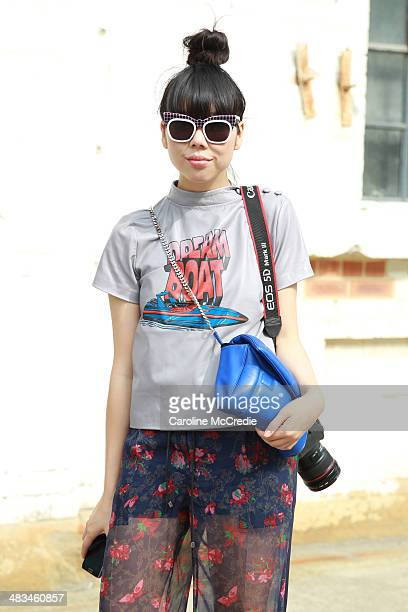 Susie Lau wearing Ashley Williams top Saici pants Nike trainers and a Julian David bag at MercedesBenz Fashion Week Australia 2014 at Carriageworks...