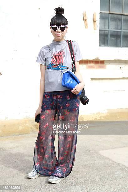 Susie Lau wearing Ashley Williams top Saici pants Nike trainers and a Julian David bag at MercedesBenz Fashion Week Australia 2014 at Carriageworks...