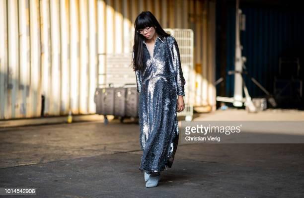Susie Lau wearing silver glitter dress seen outside Ganni during the Copenhagen Fashion Week Spring/Summer 2019 on August 9 2018 in Copenhagen Denmark