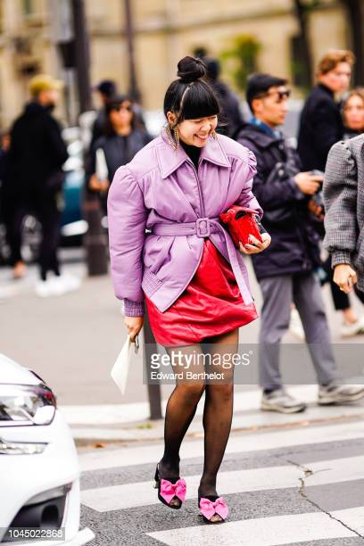 Susie Lay wears a pale purple jacket a red dress shoes with pink bow ties outside Miu Miu during Paris Fashion Week Womenswear Spring/Summer 2019 on...