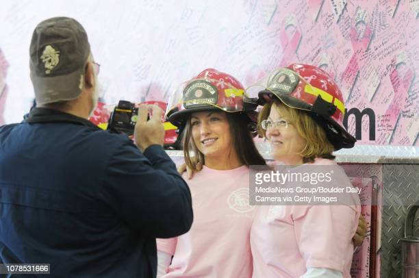 Susie Williams center and Arlene Williams pose for a picture in front of the pink fire truck taken by Bernie Williams all from Westminster at the...