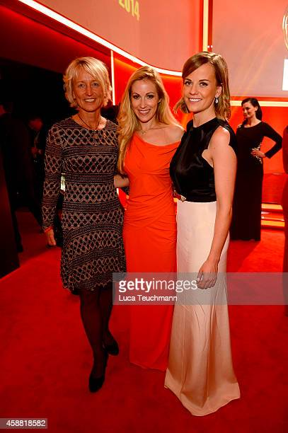 Susie Wolff Andrea Kaiser and Isolde Holderied attend 'Goldenes Lenkrad' Award 2014 at Axel Springer Haus on November 11 2014 in Berlin Germany
