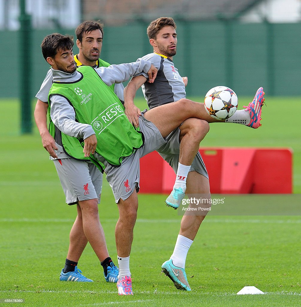 Suso and Fabio Borini of Liverpool during a training session at Melwood Training ground on September 15, 2014 in Liverpool, England.