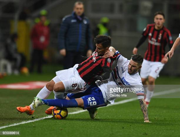 Suso of AC Milan and Nicola Murru of UC Sampdoria compete for the ball during the serie A match between AC Milan and UC Sampdoria at Stadio Giuseppe...