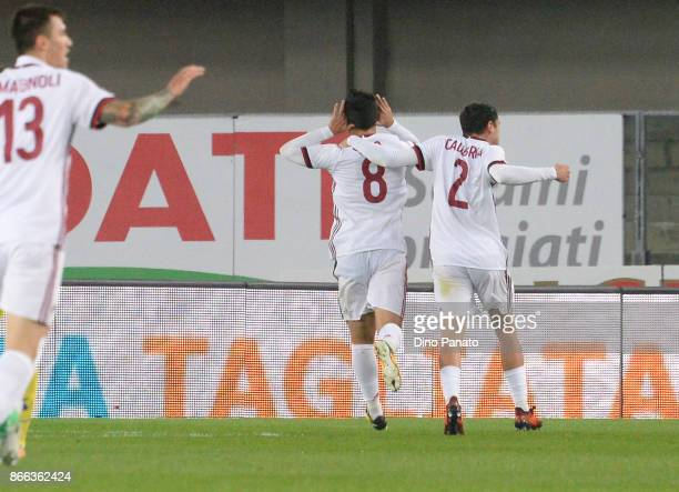 Suso of AC Milan celebrates after scoring his opening goal during the Serie A match between AC Chievo Verona and AC Milan at Stadio Marc'Antonio...