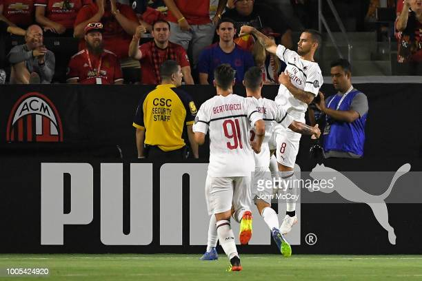 Suso of AC Milan celebrates with teammates after scoring a first half goal against Manchester United during the International Champions Cup 2018 at...