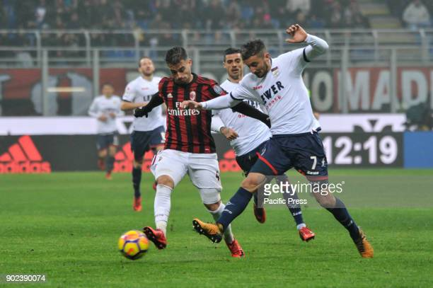 Suso of AC Milan competes for the ball with Federico Ceccherini of FC Crotone during Serie A football AC Milan versus Crotone AC Milan wins the match...