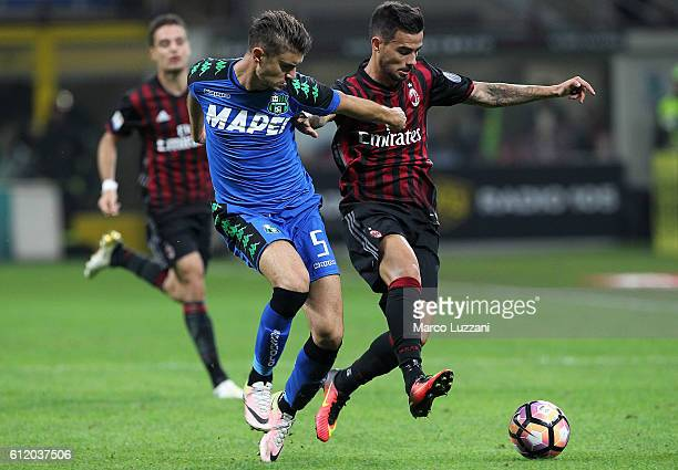 Suso of AC Milan competes for the ball with Luca Antei of US Sassuolo during the Serie A match between AC Milan and US Sassuolo at Stadio Giuseppe...