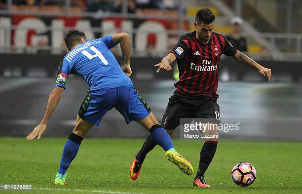 Suso of AC Milan is challenged by Francesco Magnanelli of US Sassuolo during the Serie A match between AC Milan and US Sassuolo at Stadio Giuseppe...