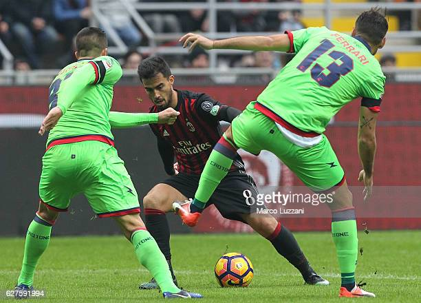 Suso of AC Milan is challenged by Gian Marco Ferrari and Bruno Mertella of FC Crotone during the Serie A match between AC Milan and FC Crotone at...