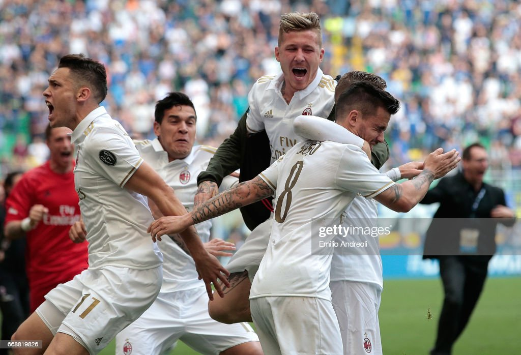 Suso of AC Milan (R) with his team-mate Juraj Kucka (C) and Lucas Ocampos (L) celebrates at the end of the Serie A match between FC Internazionale and AC Milan at Stadio Giuseppe Meazza on April 15, 2017 in Milan, Italy.