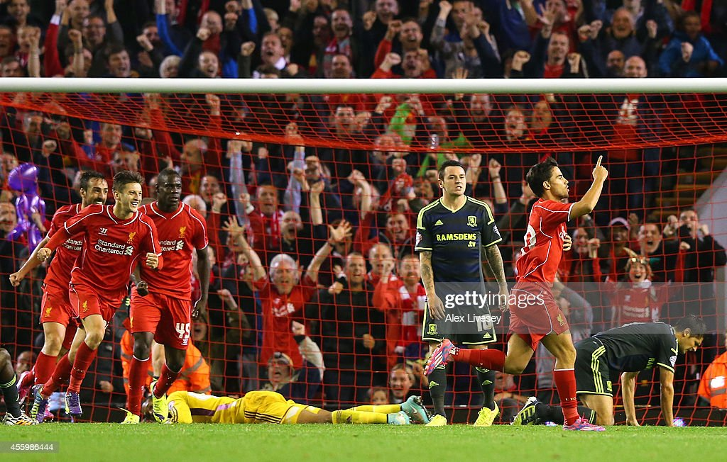 Suso of Liverpool celebrates after scoring his goal during the Capital One Cup Third Round match between Liverpool and Middlesbrough at Anfield on September 23, 2014 in Liverpool, England.