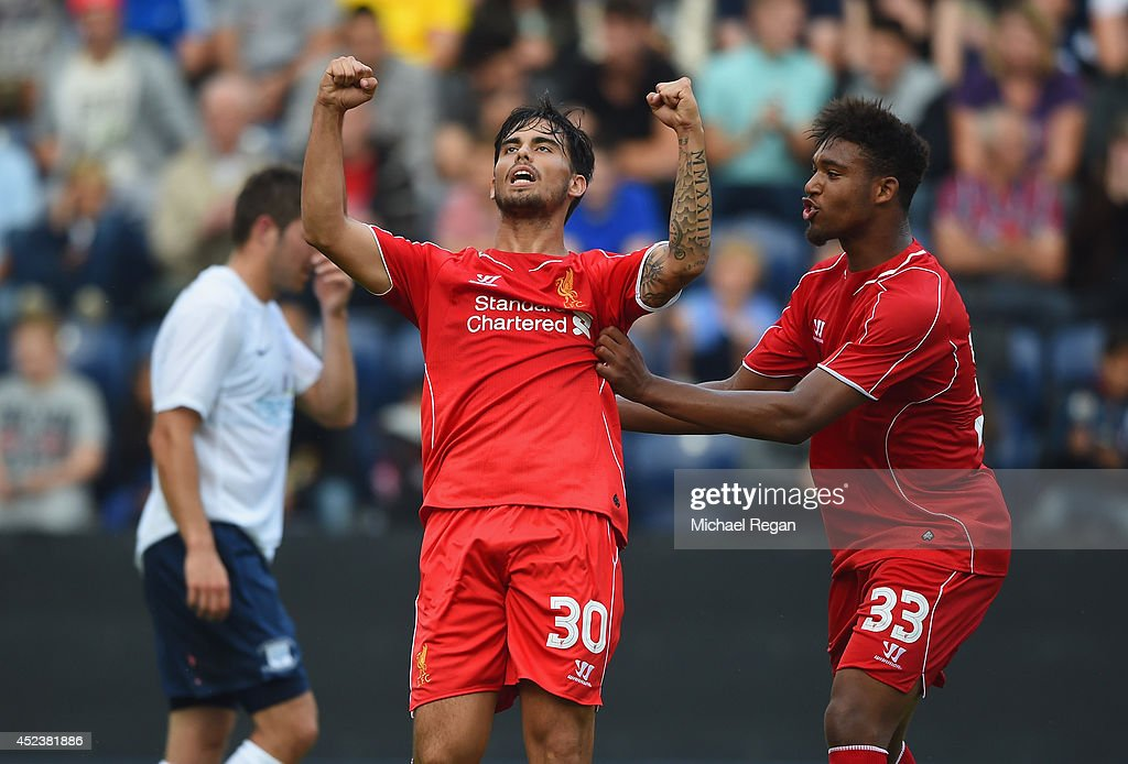 Suso of Liverpool celebrates scoring with team mate Jordan Ibe during the pre season friendly match between Preston North End and Liverpool at Deepdale on July 19, 2014 in Preston, Lancashire.
