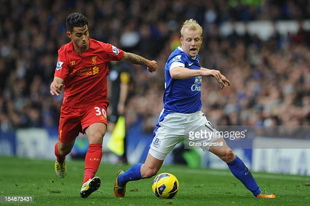 Suso of Liverpool competes with Steven Naismith of Everton during the Barclays Premier League match between Everton and Liverpool at Goodison Park on...