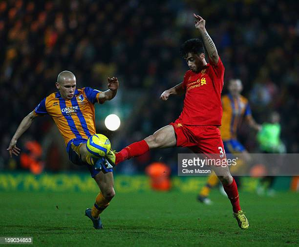 Suso of Liverpool is challenged by Lindon Meikle of Mansfield Town during the FA Cup with Budweiser Third Round match between Mansfield Town and...