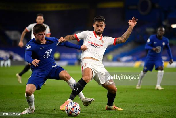 Suso of Sevilla battles for possession with Mason Mount of Chelsea during the UEFA Champions League Group E stage match between Chelsea FC and FC...