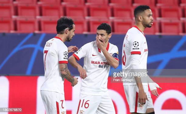 Suso of Sevilla celebrates with Jesus Navas after scoring his team's first goal during the UEFA Champions League Round of 16 match between Sevilla FC...