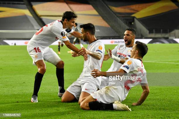 Suso of Sevilla FC celebrates with teammates after scoring his team's first goal during the UEFA Europa League Semi Final between Sevilla and...