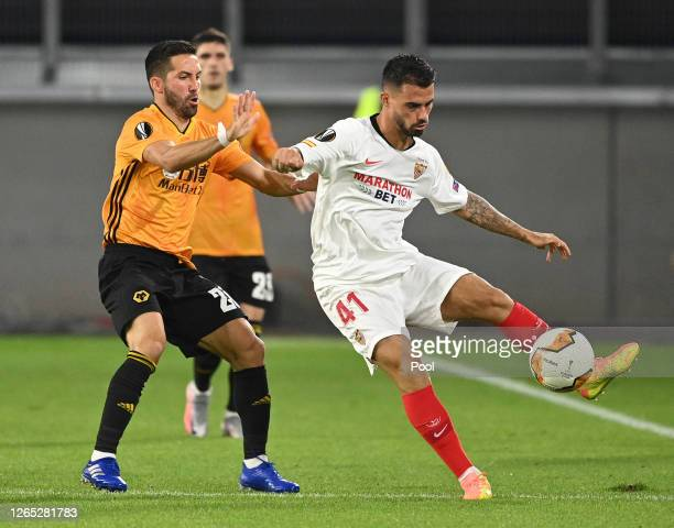 Suso of Sevilla is put under pressure by Joao Moutinho of Wolverhampton Wanderers during the UEFA Europa League Quarter Final between Wolves and...