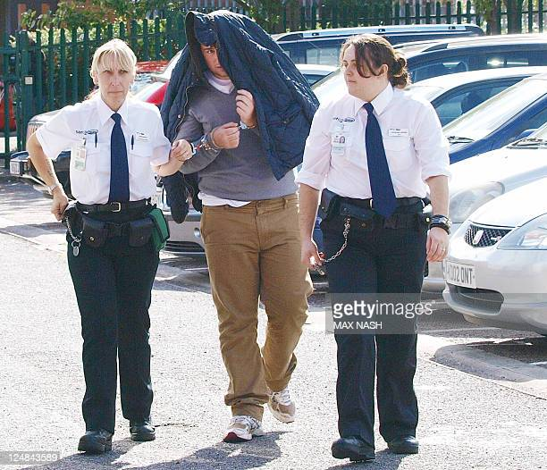 A suspect believed to be James 'Jimmy' Connors arrives at Luton Magistrates Court north of London on September 13 2011 Four men charged with slavery...