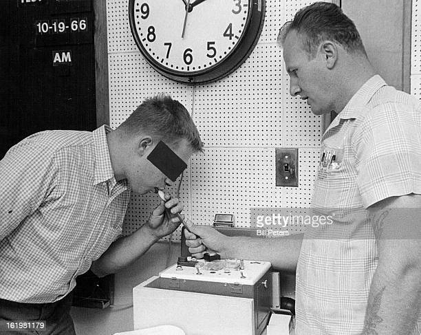 NOV 19 1966 NOV 20 1966 Suspect blows into tube of police Breathalyzer which will give a reading on his blood alcohol content Police technician...