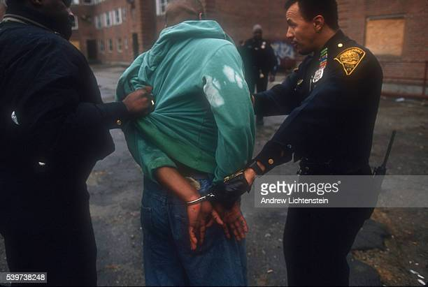 Suspect in a drug bust is arrested and put in handcuffs by Bridgeport police officers. In the mid-1990s, East Bridgeport became a neighborhood of...