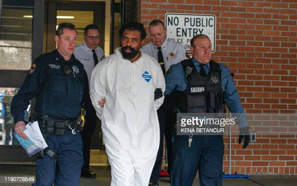 TOPSHOT Suspect in Hanukkah celebration stabbings Thomas Grafton 37 years old from Greenwood Lake leaves the Ramapo Town Hall in Airmont New York...